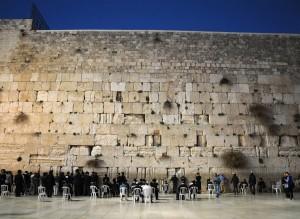 Orthodox Jewish men praying at the Western Wall in Jerusalem bef